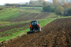 Tractor. At work on a field stock image