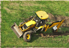Tractor. Without wheel on grass-lawn Royalty Free Stock Photography