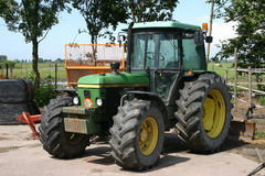 Tractor. A green tractor on a farm Stock Image