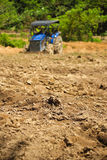 Tractor. S are plowing the soil for planting Stock Images