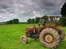The tractor. Rusty tractor in a irish field royalty free stock photos