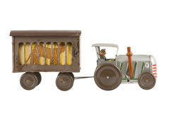 Tractor. Old toy tractor on white background stock photography