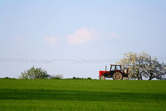Tractor. A countryside with a tractor on the field Stock Images