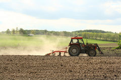 Tractor. A countryside with a tractor on the field Stock Photography