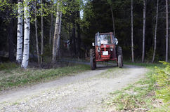 Tractor. Driving at the sand road Royalty Free Stock Images