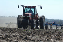 Tractor. A tractor preparing a field for spring planting in rural Warren County, Iowa royalty free stock image