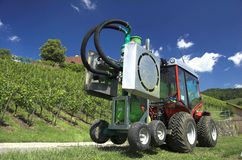 Tractor. A modern tractor in the wineyard with blue sky Stock Images