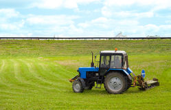 Tractor. Working on cutting grass in rural areas Royalty Free Stock Images