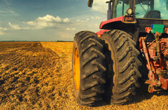 Tractor on the agricultural field Stock Photos