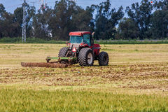 Tractor on agricultural field. Royalty Free Stock Photo
