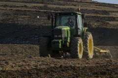 Tractor agricultural plowing the land Royalty Free Stock Image