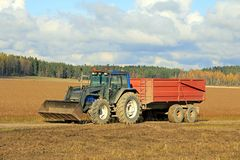 Tractor and Agricultural Trailer on Flax Field stock photo