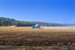 Tractor for agricultural work in a plowed field.  Royalty Free Stock Photography