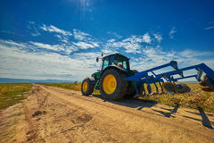 Tractor. On agriculture field in the summer Royalty Free Stock Image
