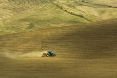 Tractor agriculture in the fields of Tuscany. Autumn agriculture works in Tuscany stock image