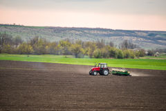 Tractor agrimotor working the ground. Royalty Free Stock Photo