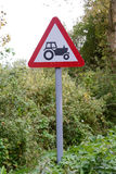 Tractor ahead sign and signpost. At side of road Stock Images