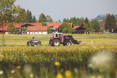 Tractor along  spring field Stock Photo