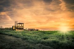 Tractor and amazing sunset Stock Images