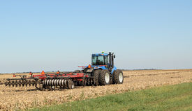 Tractor And Plow Royalty Free Stock Photos