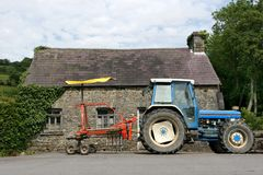Tractor And Swather Stock Image
