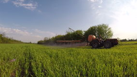 Tractor applying herbicide stock footage