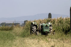 Tractor in arable land Stock Image