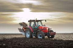 Tractor At Sunset Royalty Free Stock Photography