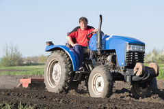Tractor with attached cutter. Man on a tractor with attached cutter Stock Photography