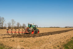 Plowing the farmland Royalty Free Stock Images