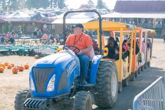 Tractor with an attached wagons driving visitors stock image