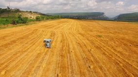 Tractor Baler Driving Along Yellow Wheat Field stock video footage