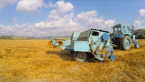 Tractor Baler Making Fresh Bale During Harvesting stock footage