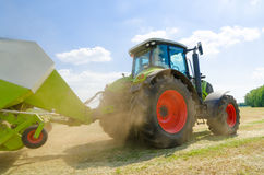 Tractor with baler Royalty Free Stock Images