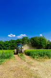 Tractor with baler Royalty Free Stock Photos