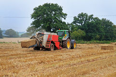 Tractor and Baling Machine Stock Image