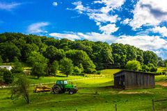 Tractor and Barn Farm Landscape stock photography
