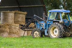 Tractor barn haystacks Stock Image