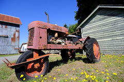 An tractor by barns Stock Photos