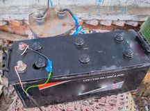 Tractor battery, charged at home, homemade charger stock images
