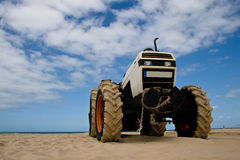 Tractor on the beach Royalty Free Stock Photo