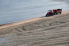 Tractor beach Stock Photography