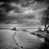 Tractor on the beach. Artistic look in black and white. Royalty Free Stock Photos