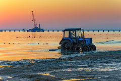 Tractor on the beach Royalty Free Stock Images