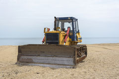 Tractor on the beach. Stock Photos