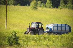 Tractor (Belarus) with cabin on a road, Lithuania Royalty Free Stock Photography