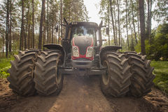 Tractor. Big tractor on the road in forest stock photos