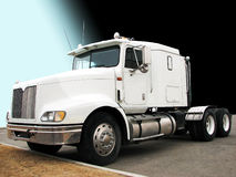Tractor - Big Truck. Picture of a white big rig/truck from the left side with a blue/black background Stock Image