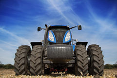 Tractor with big wheels in the field Stock Photos