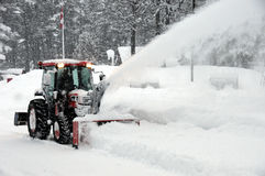 Tractor blowing snow Royalty Free Stock Image
